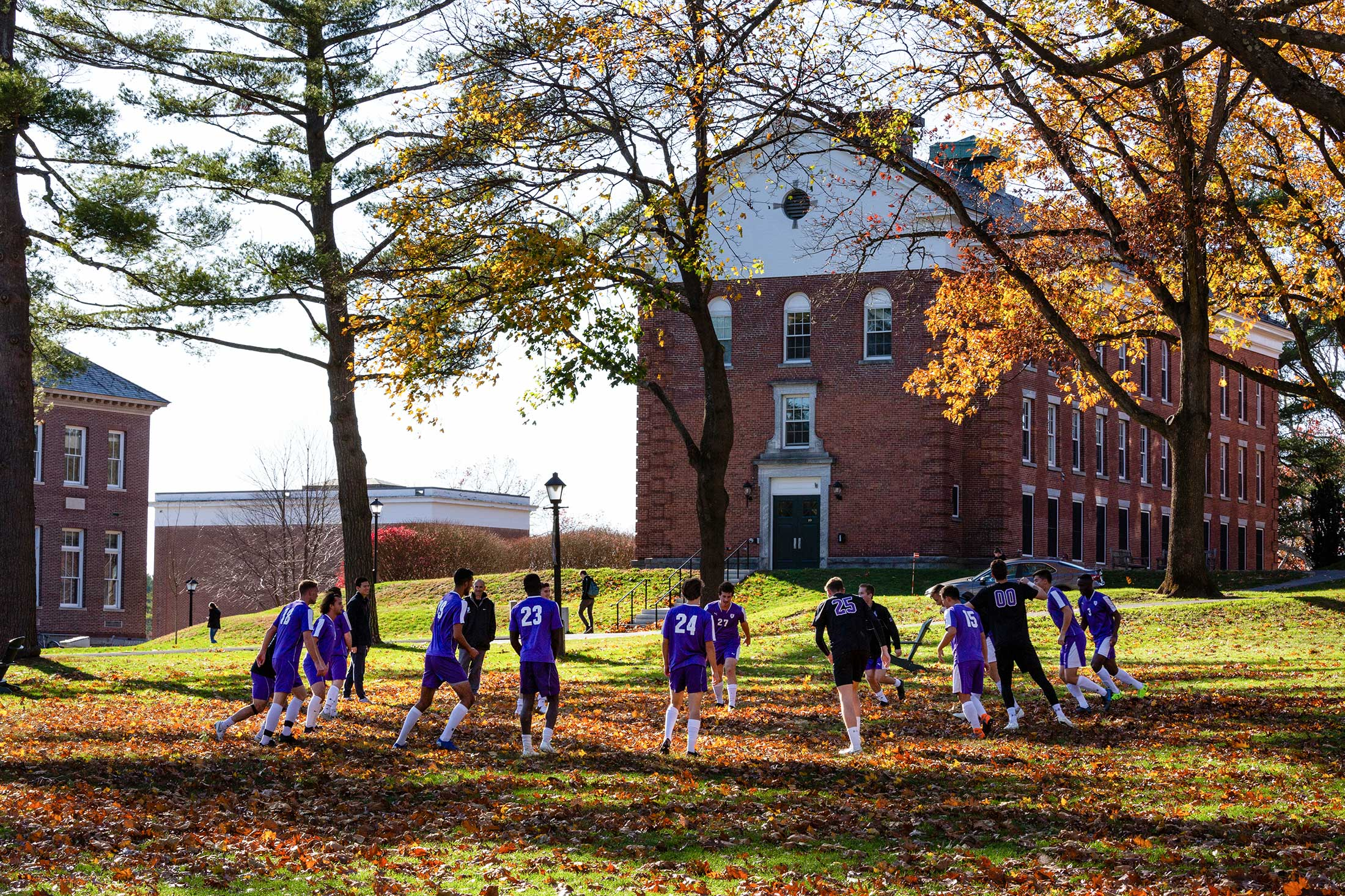 The men's soccer team practicing on the Quad
