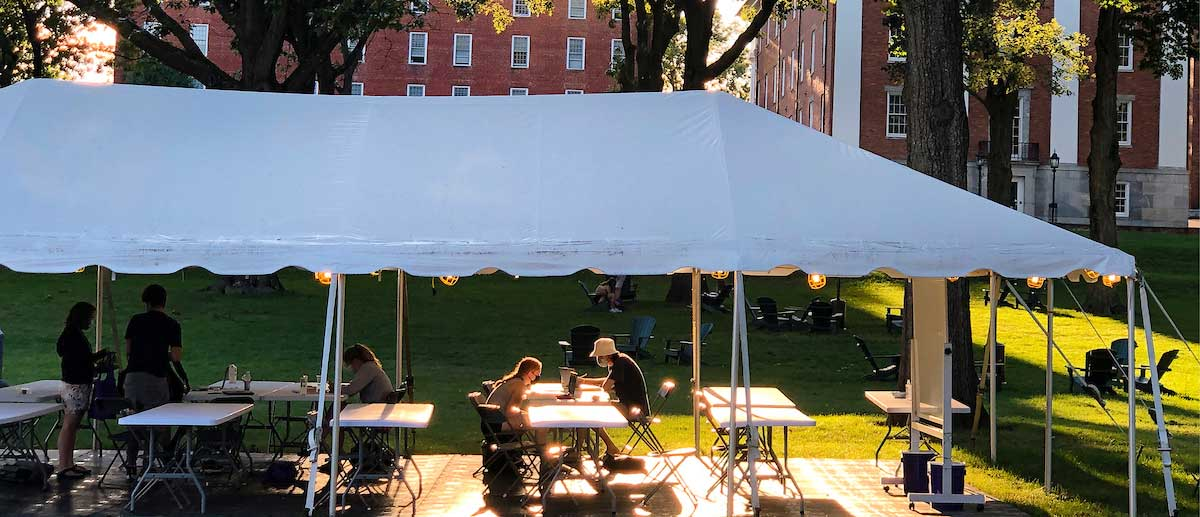 students studying under a tent on the amherst college campus