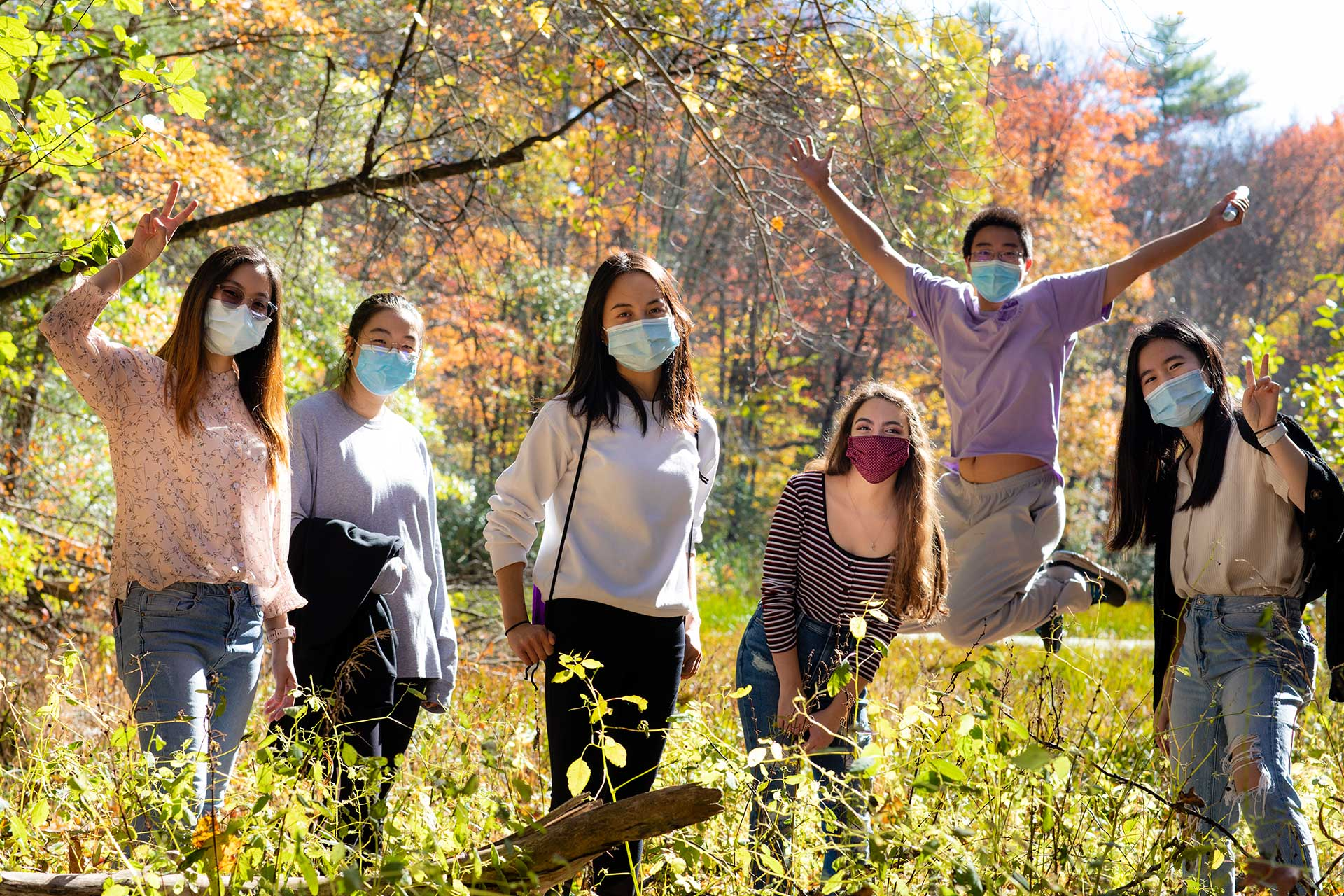 Six students pose for a photo on the sanctuary land