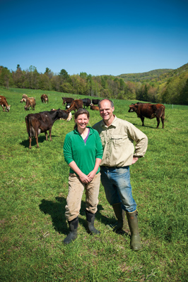 Amy Klippenstein '89 and Paul Lacinski '89 with cows on Sidehill Farm