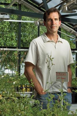 Michael Hood in greenhouse