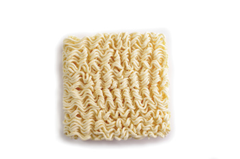 Block of uncooked instant noodles