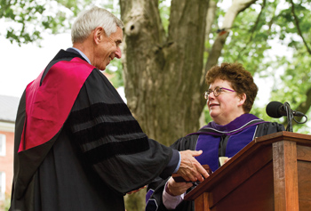 Kent W. Faerber '63 receives the Medal for Eminent Service from Biddy Martin.