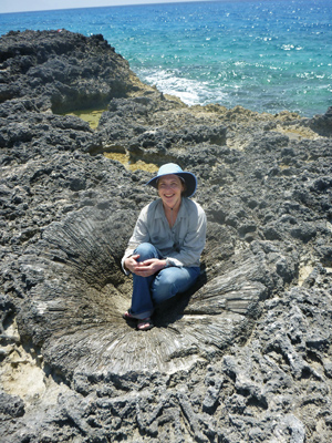 Dutton sits in a fossil coral head in the Bahamas.