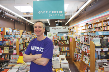 Jonah Zimiles '79 in his bookstore, wearing an Amherst T-shirt