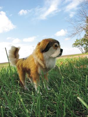 Tibetan mastiff sculpture in grassy field