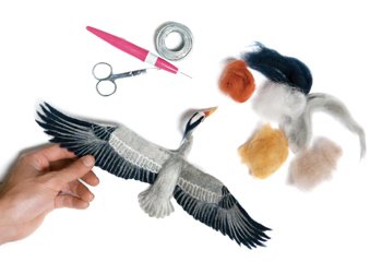 Needle felting supplies and goose sculpture
