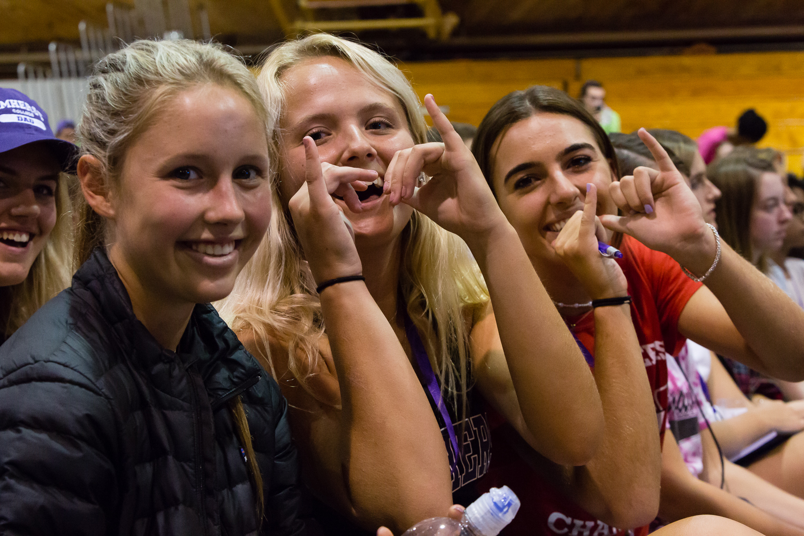"New students showing ""tusks up"" with a hand gesture, a nod to the Amherst College mascot."