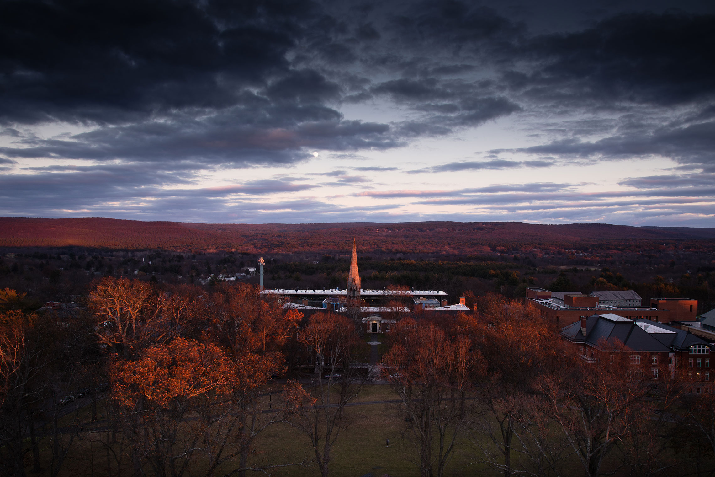 Moonrise creating beautiful lighting over the campus of Amherst College.