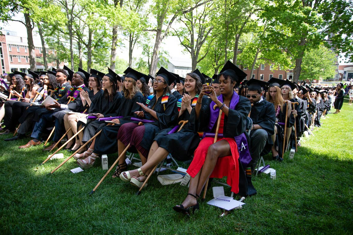 Amherst graduates sitting with their traditional canes