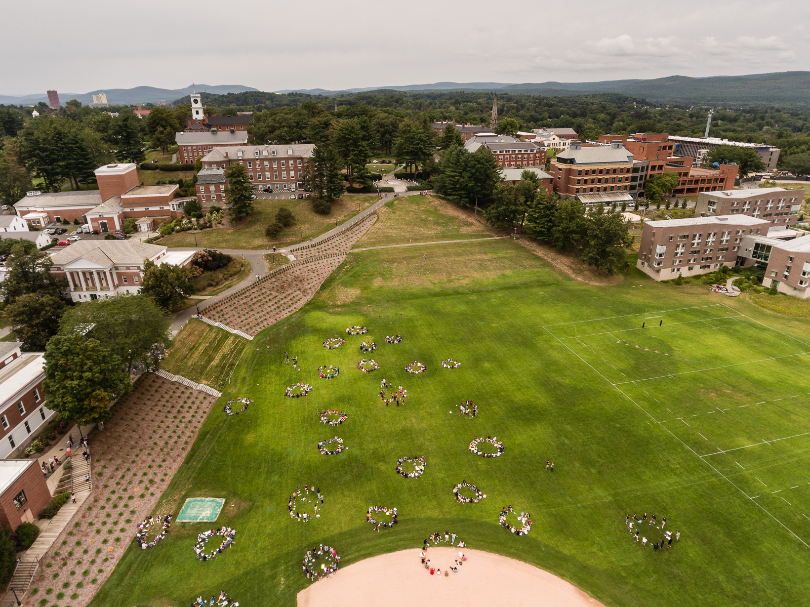 "An aerial view of students gathered in ""squads"" outside."