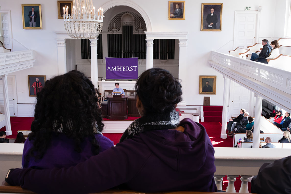 President Martin speaking to Amherst families in Johnson Chapel.