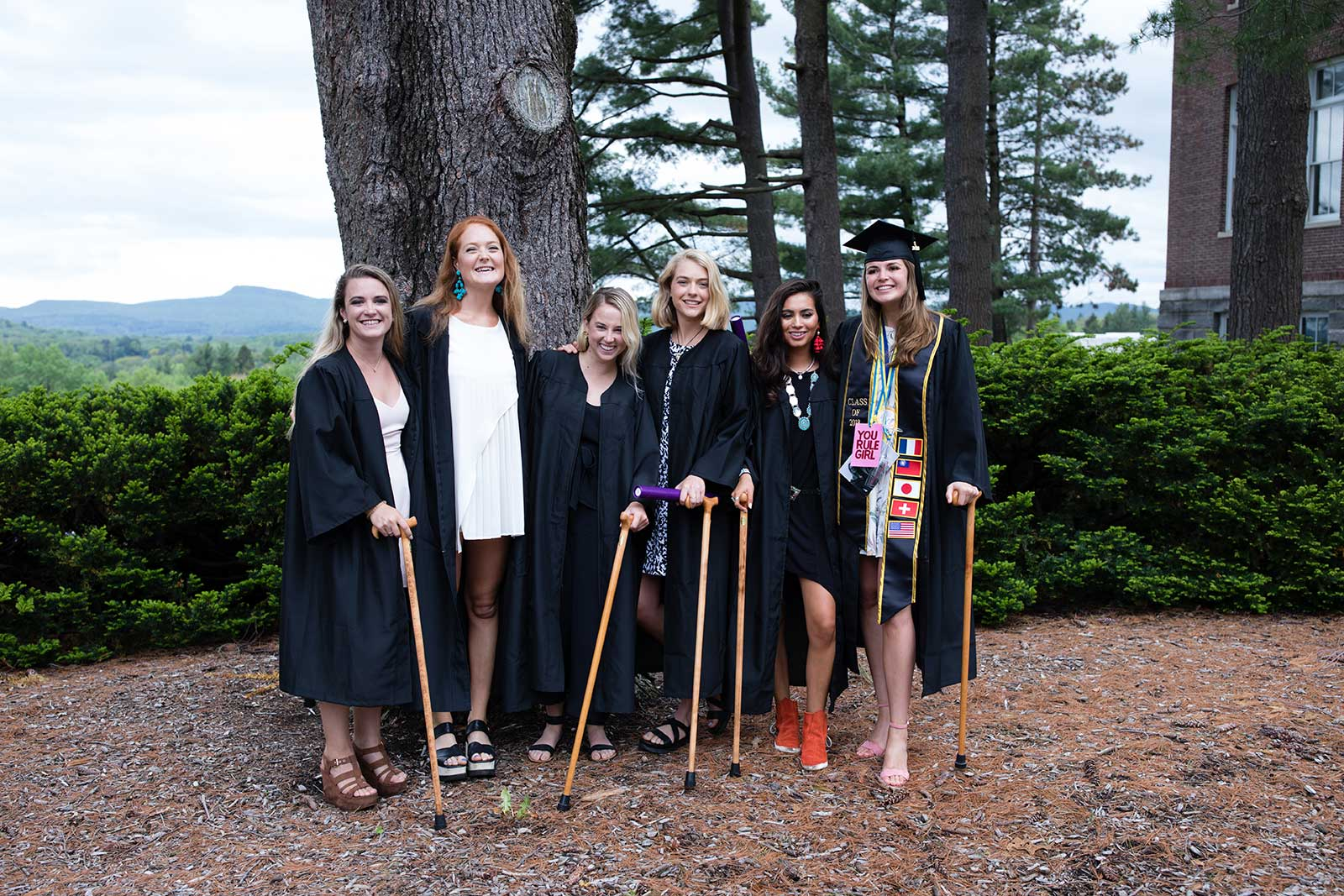 Graduates posing with their Conway Canes after the ceremony