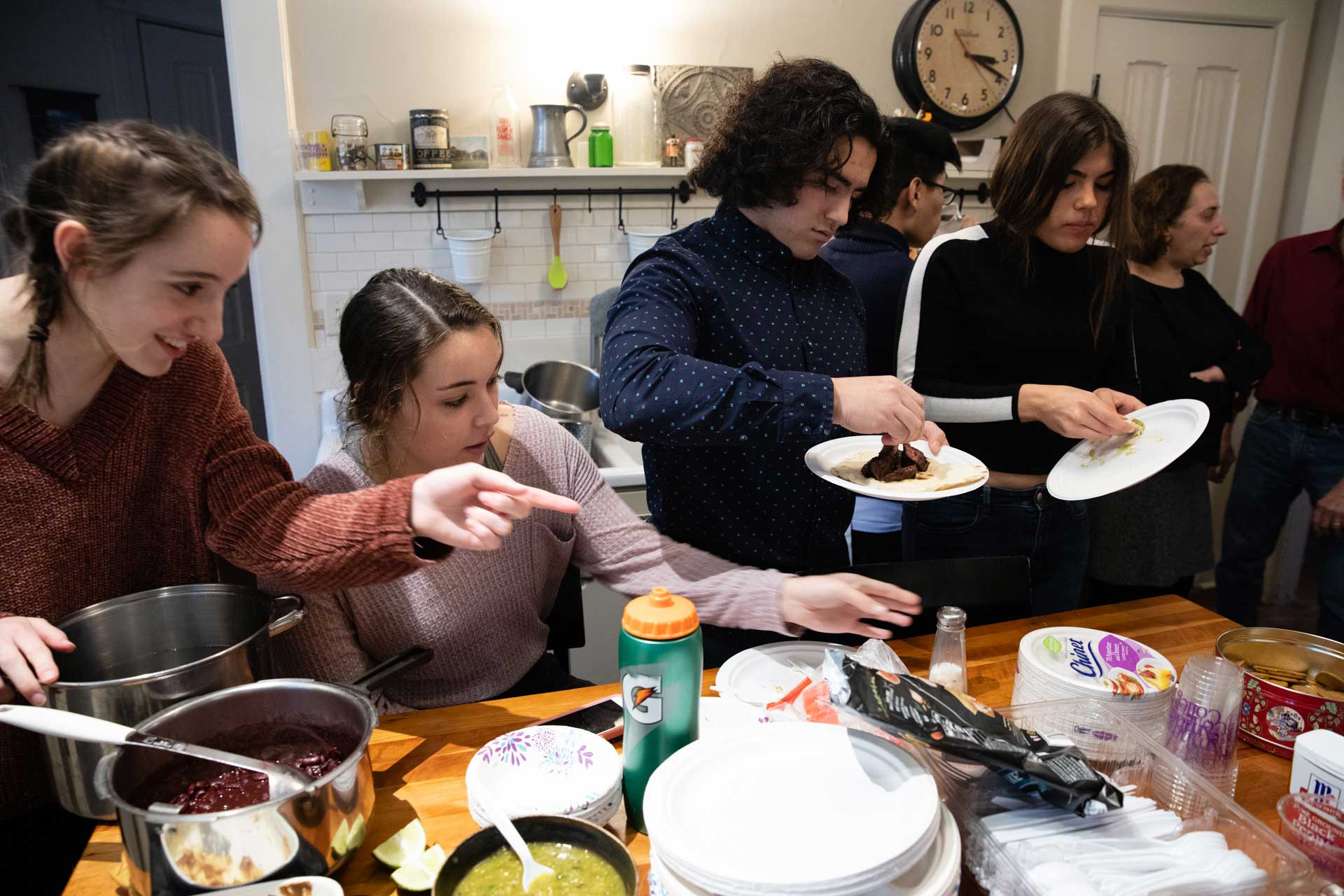College students eating together in a kitchen
