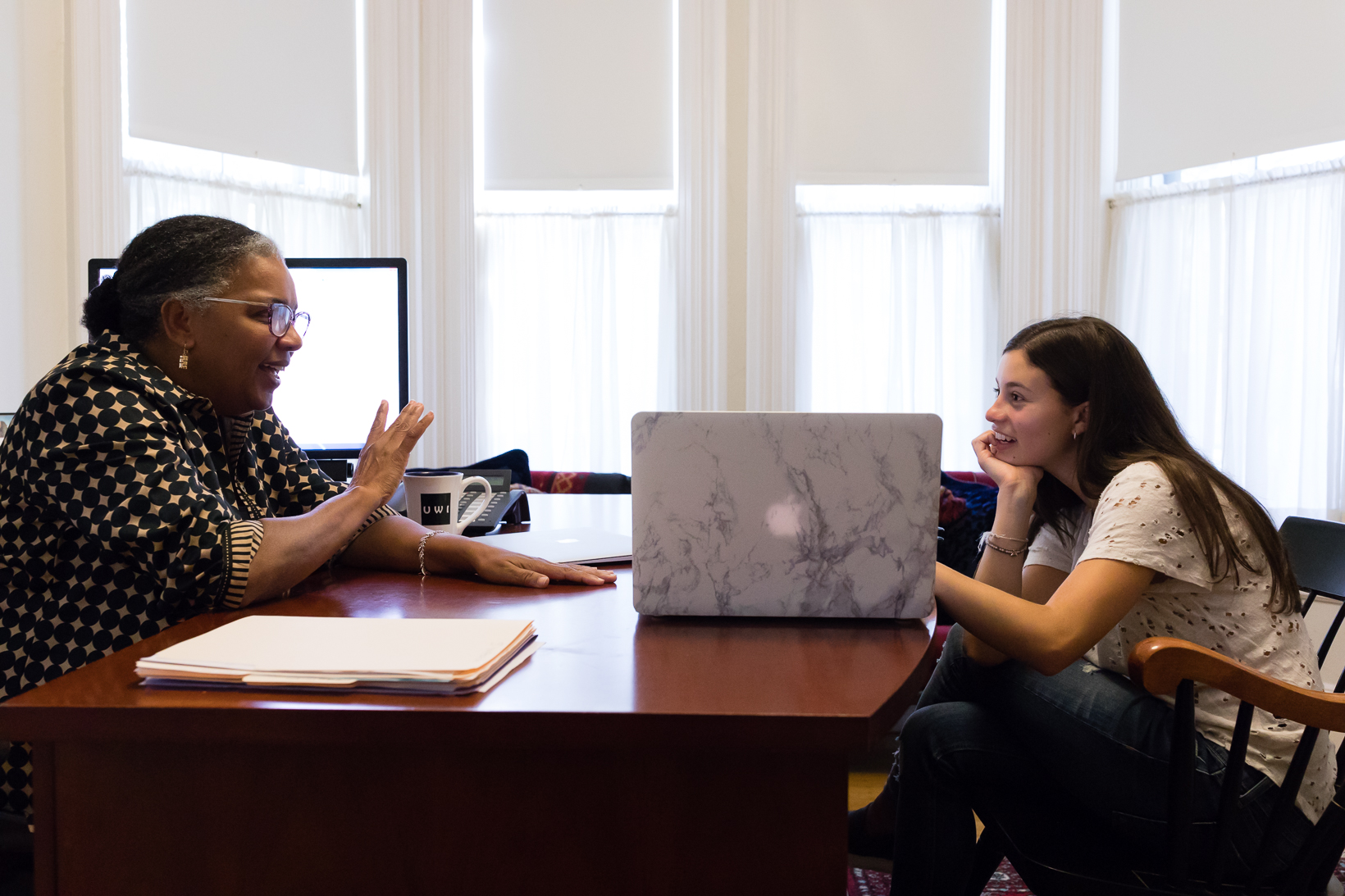 A student receives a one on one advising session with a faculty member.