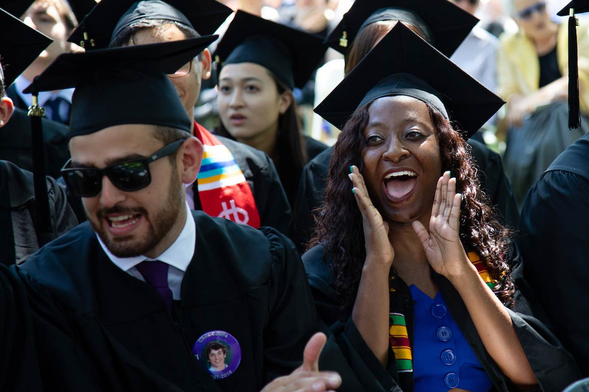 Seniors cheering for each other during Commencement