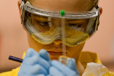 Chemistry student in goggles