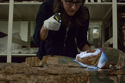 Conservator Erin Toomey Examines the Mumy Case