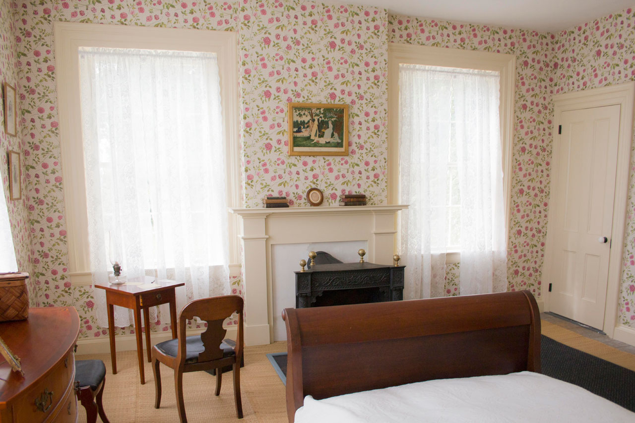 Emily Dickinson's bedroom with a small writing desk by the window
