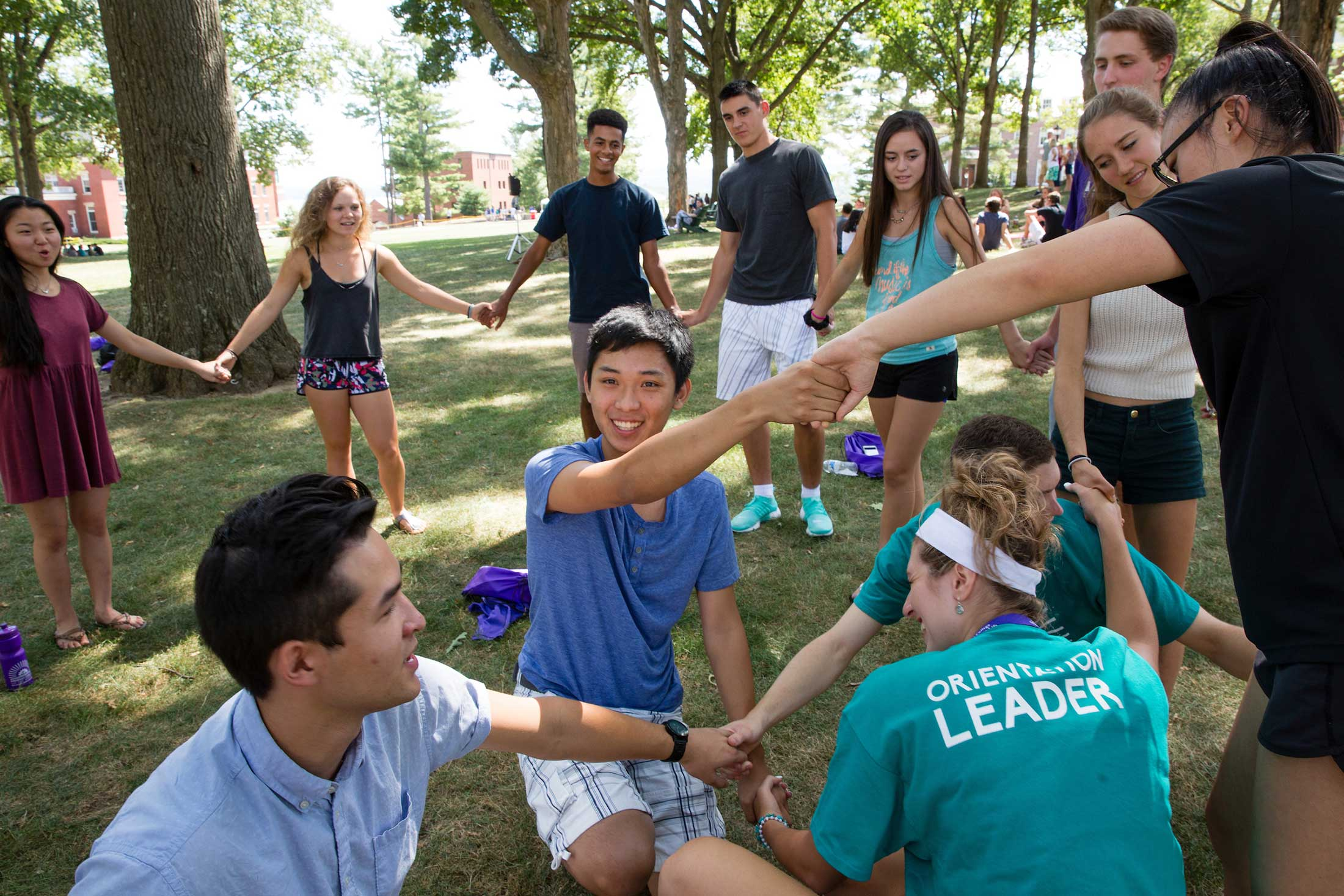 Students participating in an ice-breaker activity during orientation