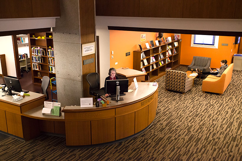 Library staff at the reference desk in Frost Library