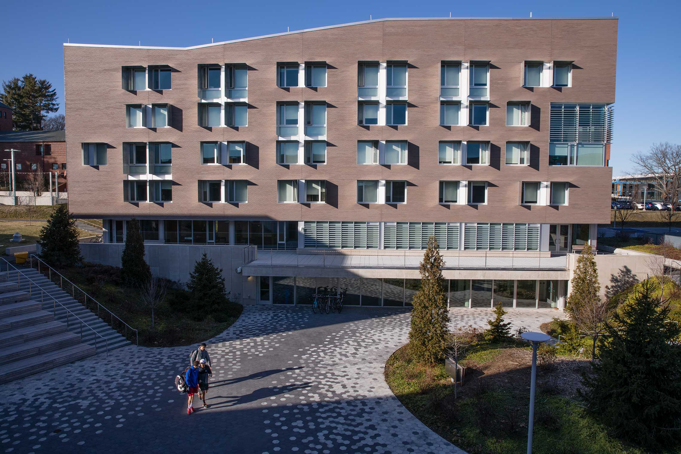 Outside view of Greenway Dorm A being renamed as Ford Hall