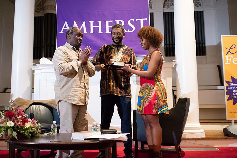 Ngugu wa Thiong'o receives a surprise birthday cake from two Amherst College students