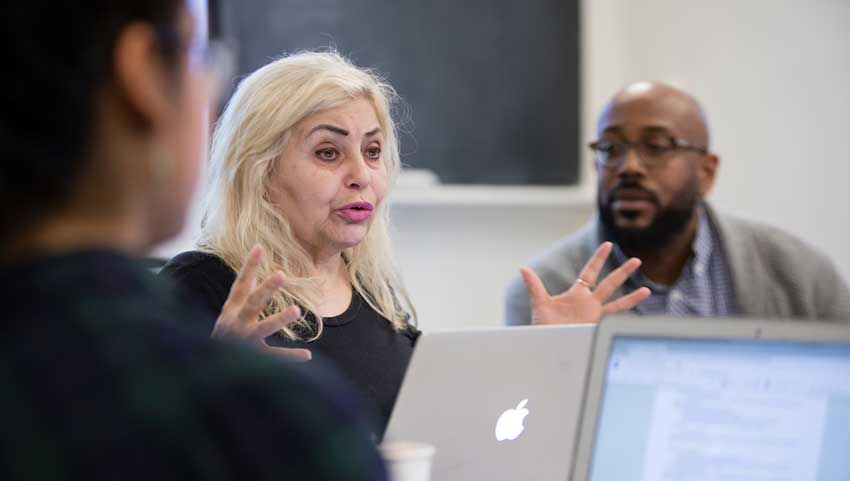 """Actress and playwright Penny Arcade speaking to students in Khary Polk's """"Queer Theory and Practice"""" seminar"""