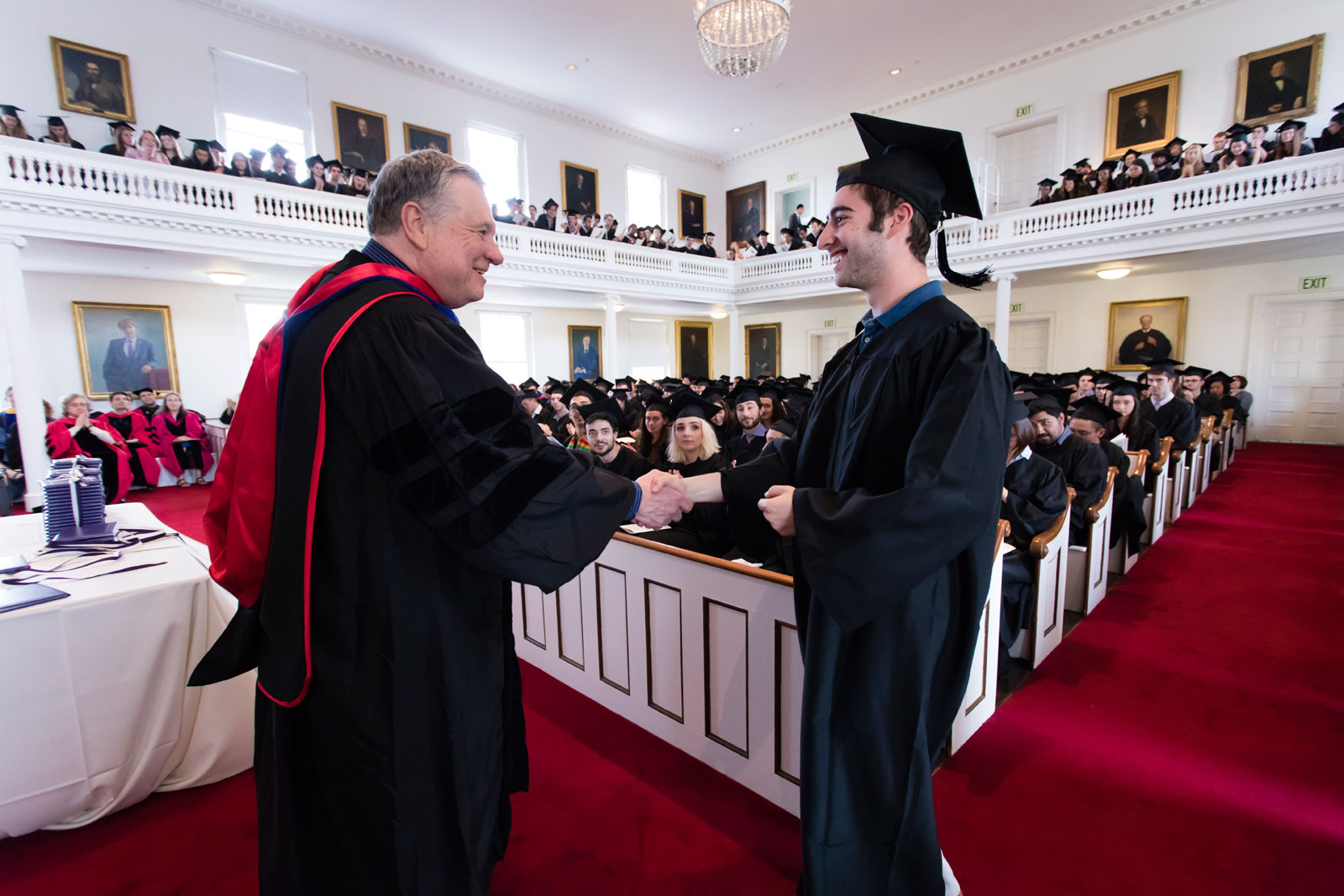 Professor Jack Cheney gives an award to a student