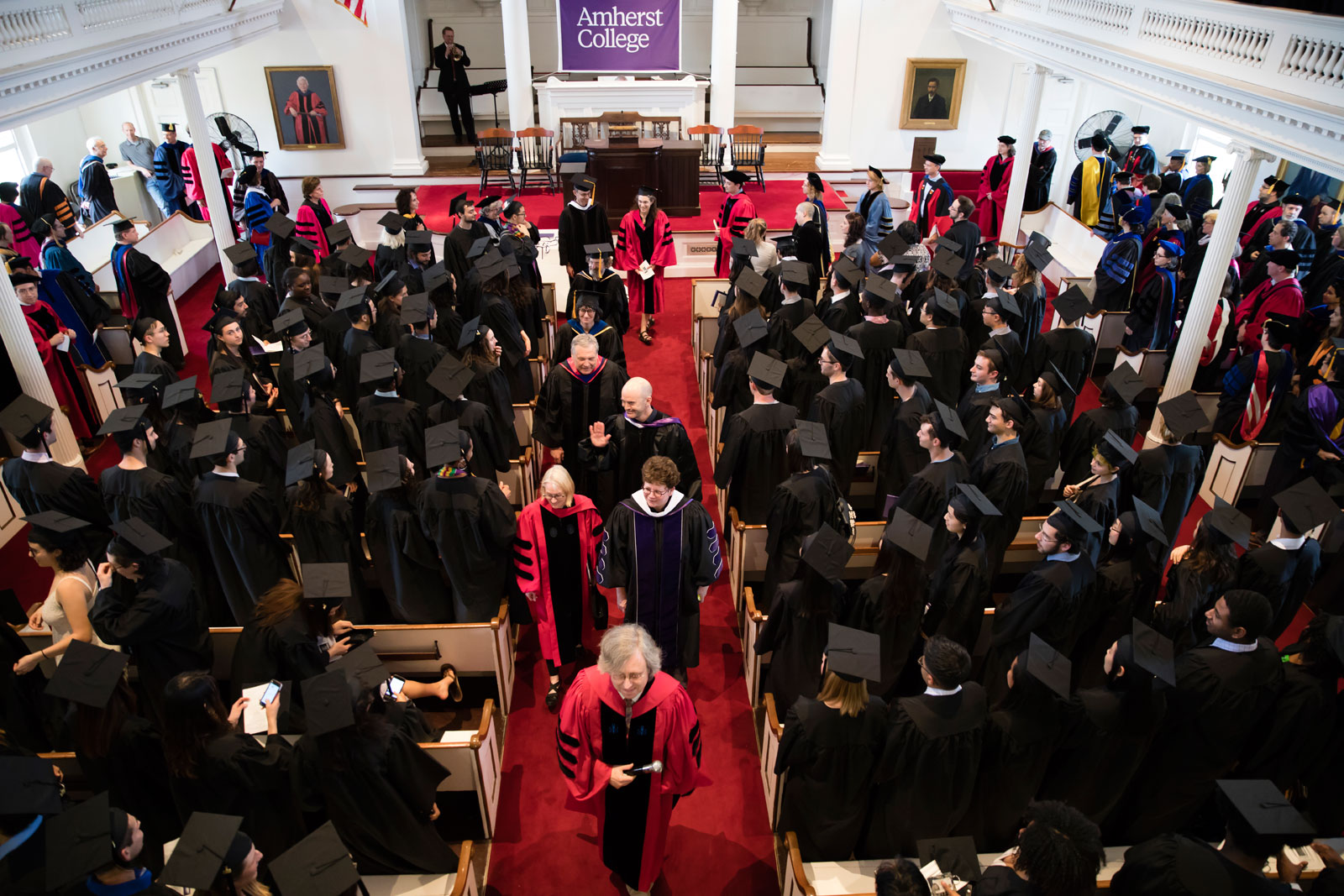 The procession of faculty enters Johnson Chapel, broader view