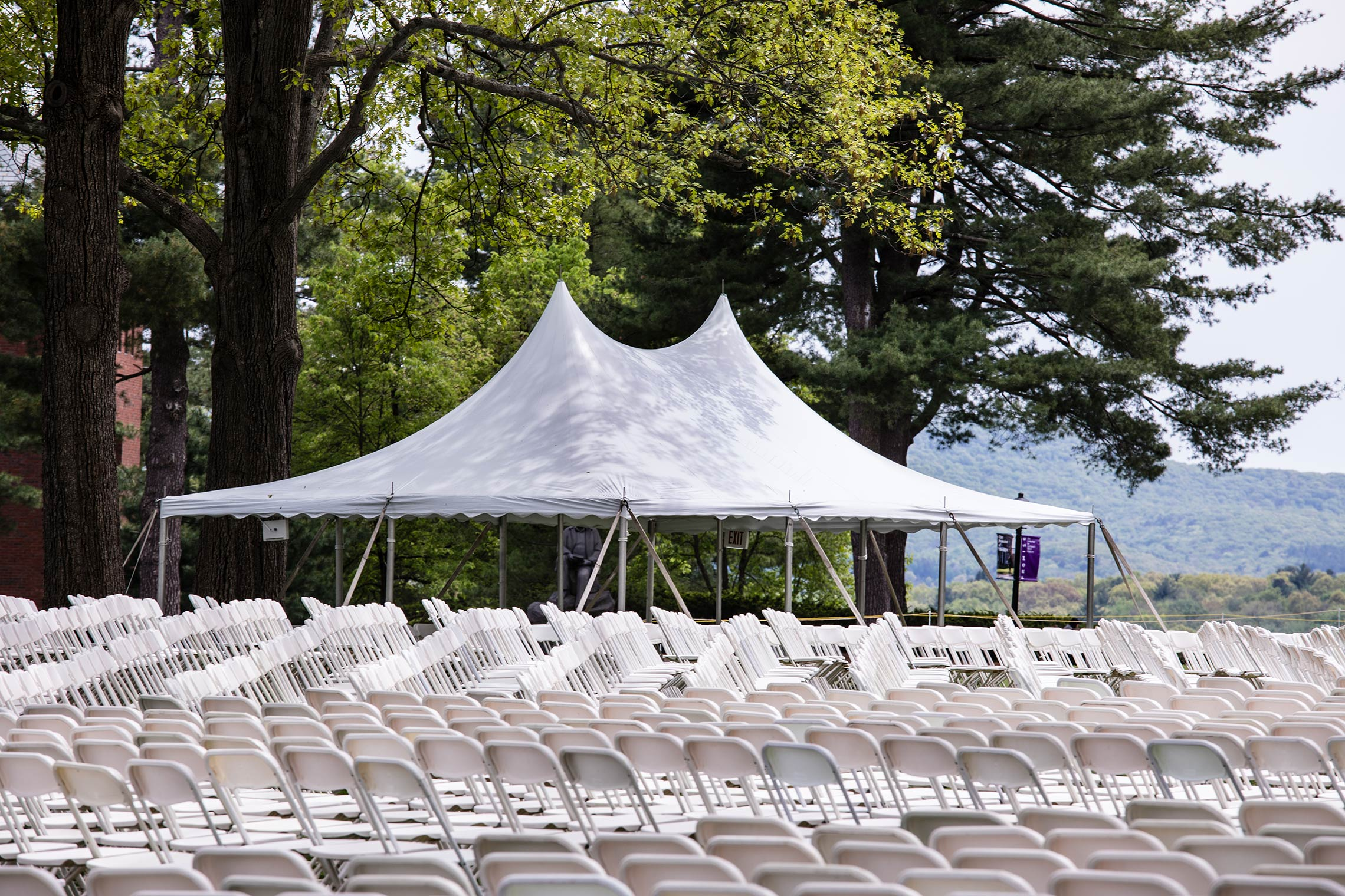 Commencement chairs begin set up on the Academic Quad