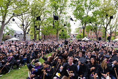 Student toss their graduation caps at Commencement at Amherst College