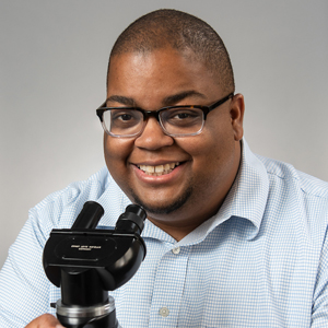 Marc Edwards with a microscope