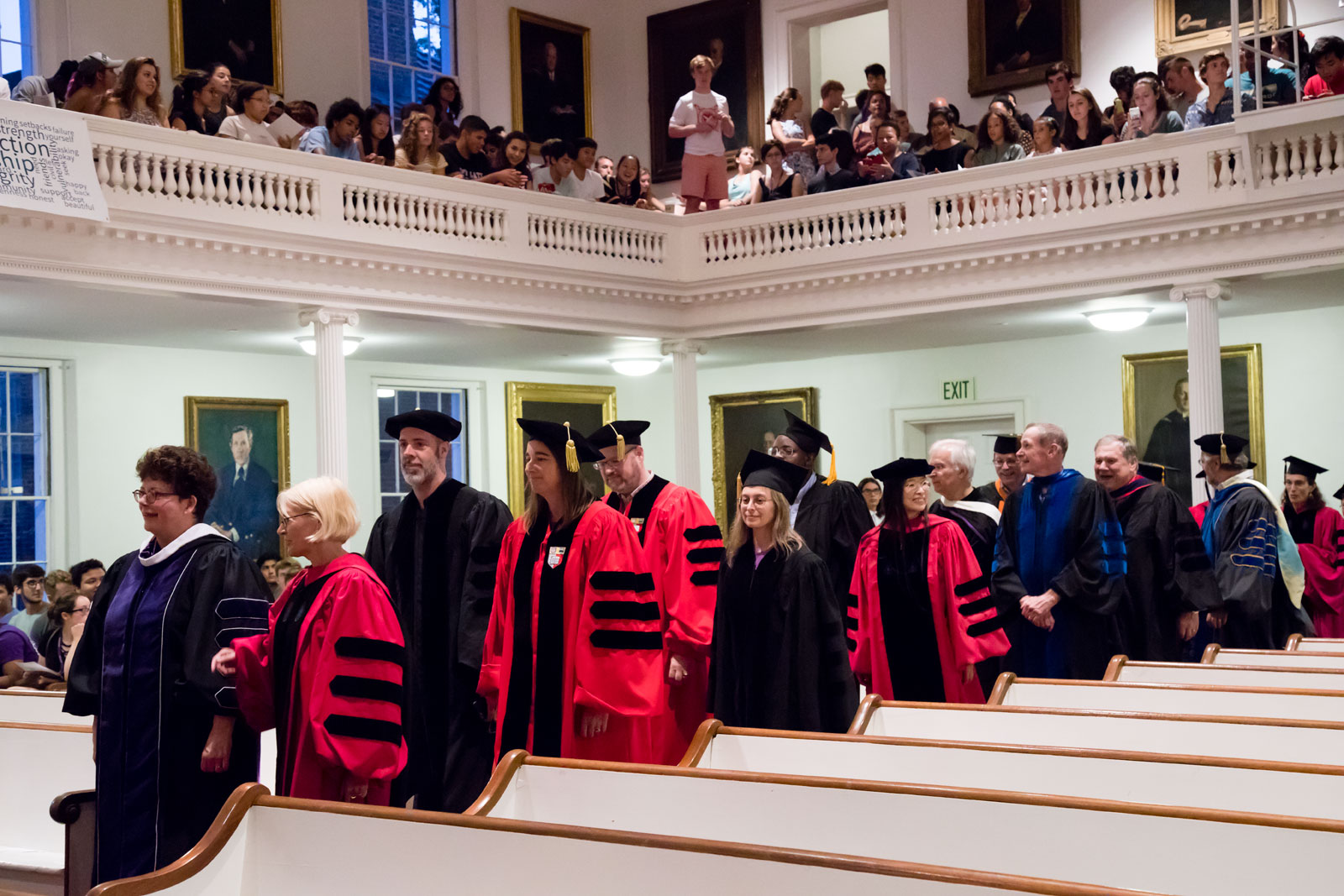 Faculty process into Johnson Chapel, wearing regalia