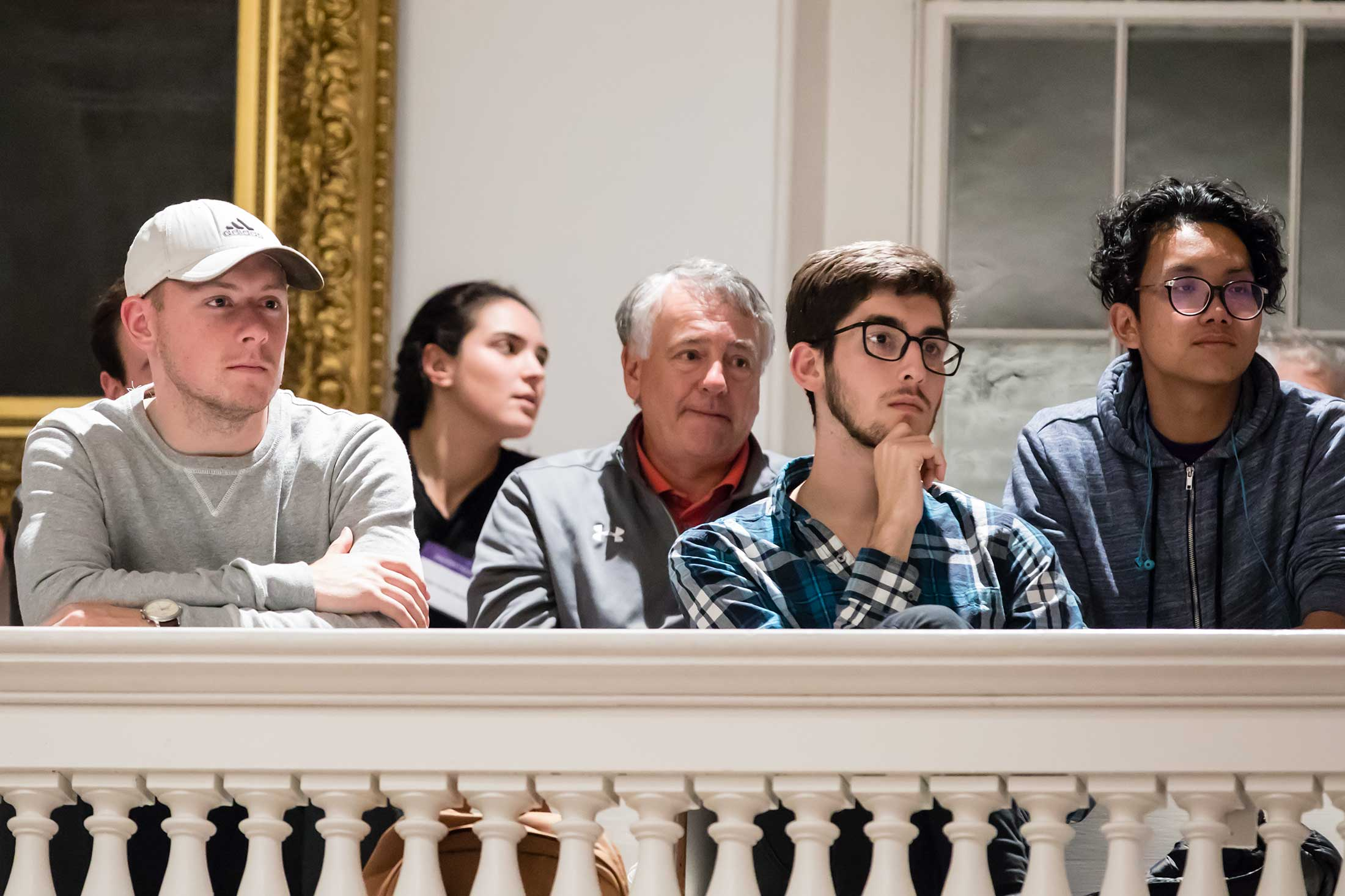 Audience members listening to author Michael Lewis speak at Amherst College