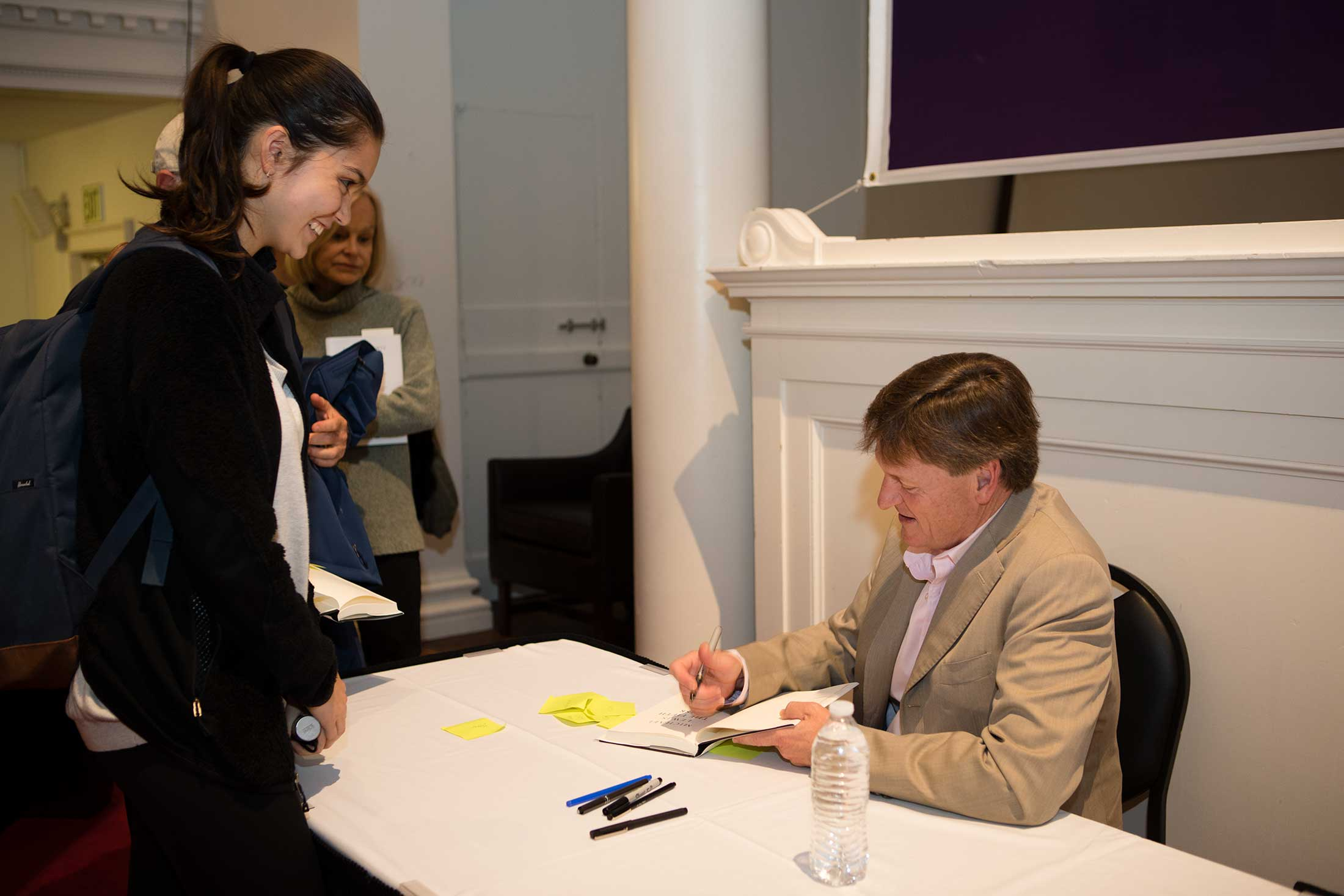 An Amherst student speking with Michael Lewis at his book signing.