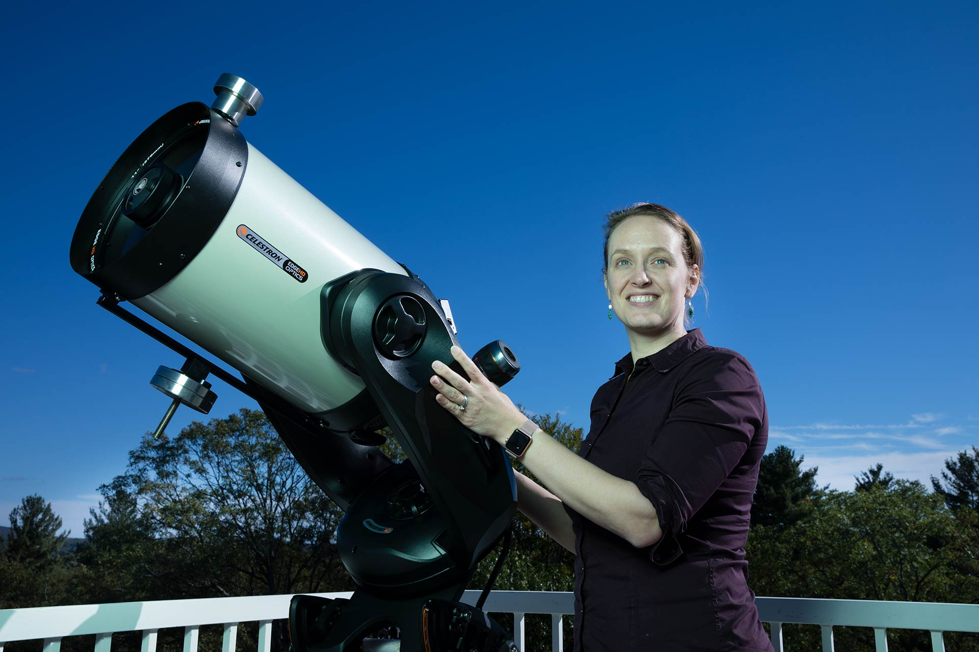 Professor Kate Follette on the roof of the Observatory with a telescope