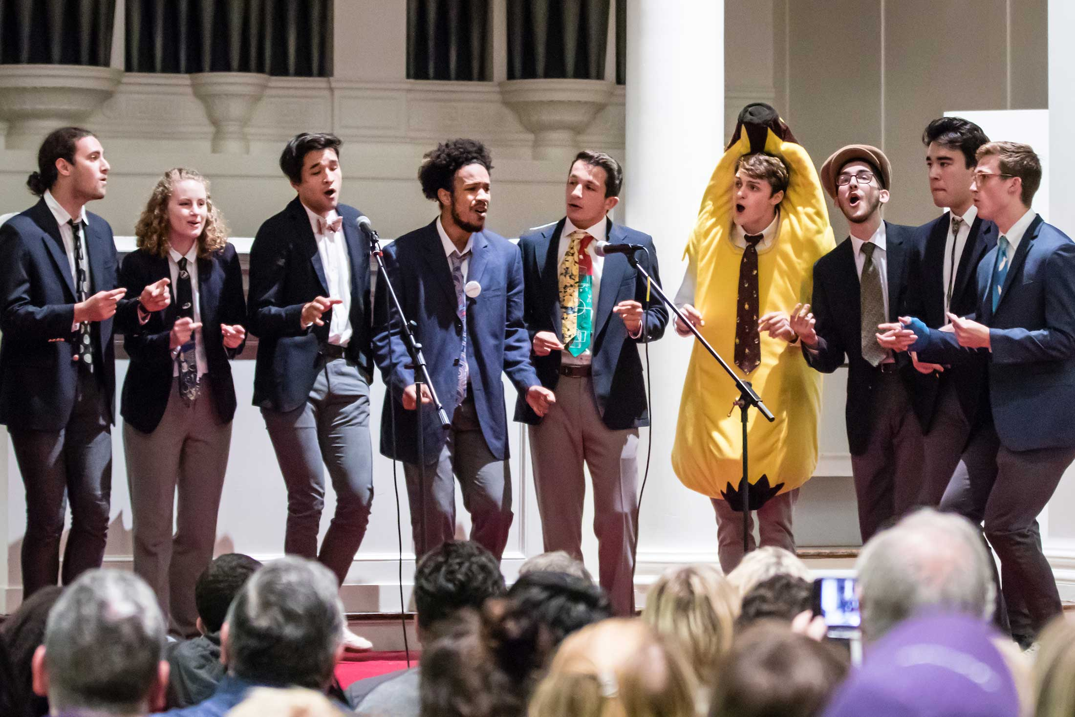 An a capella group performs (one member is dressed like a banana)