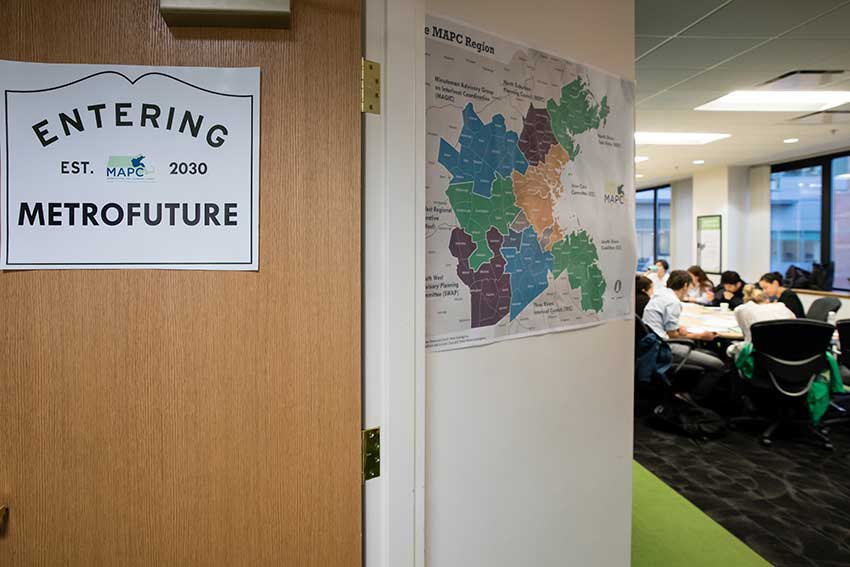 A sign on the door to the conference room states: Entering Metrofuture