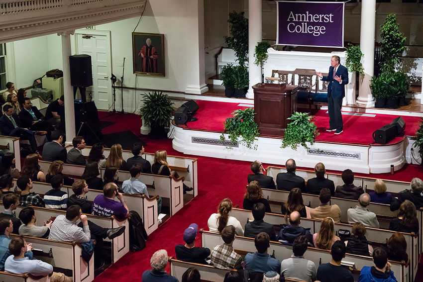 John Kasish addressing the audience in Johnson Chapel at Amherst College