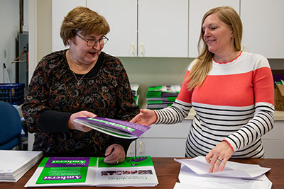 Admission staff preparing admit packages