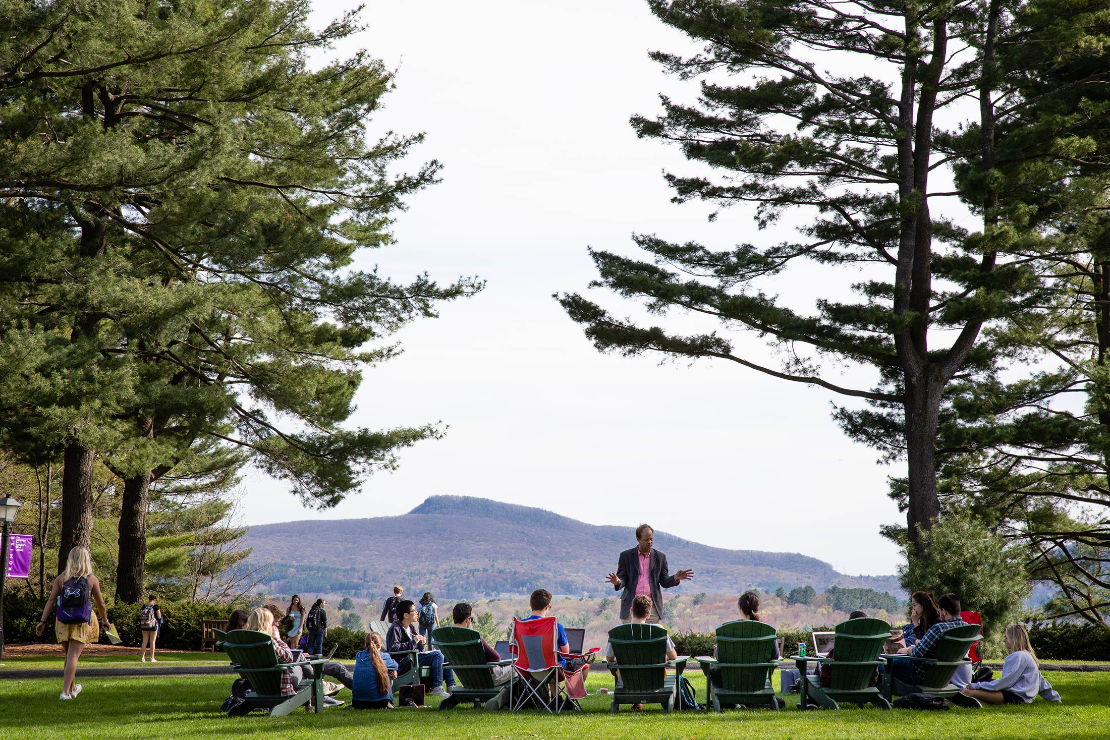 A professor holds a class outside on the academic quad