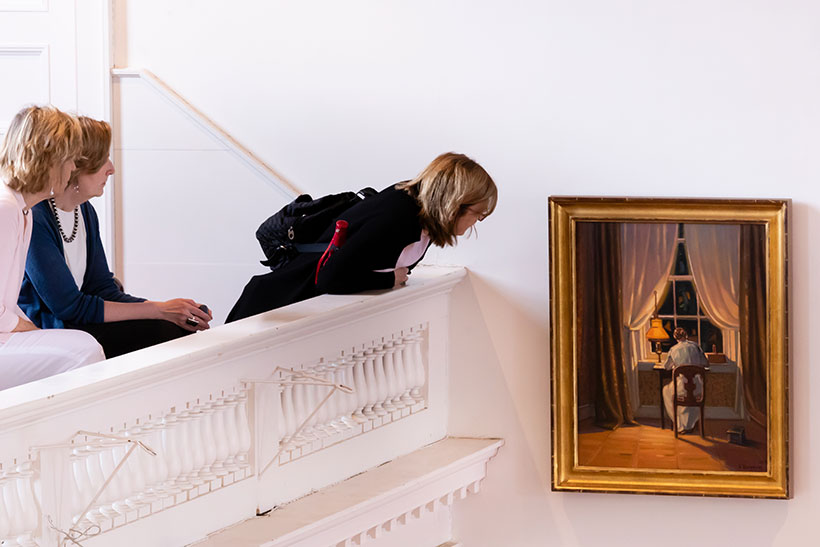 People examining one of the Emily Dickinson paintings
