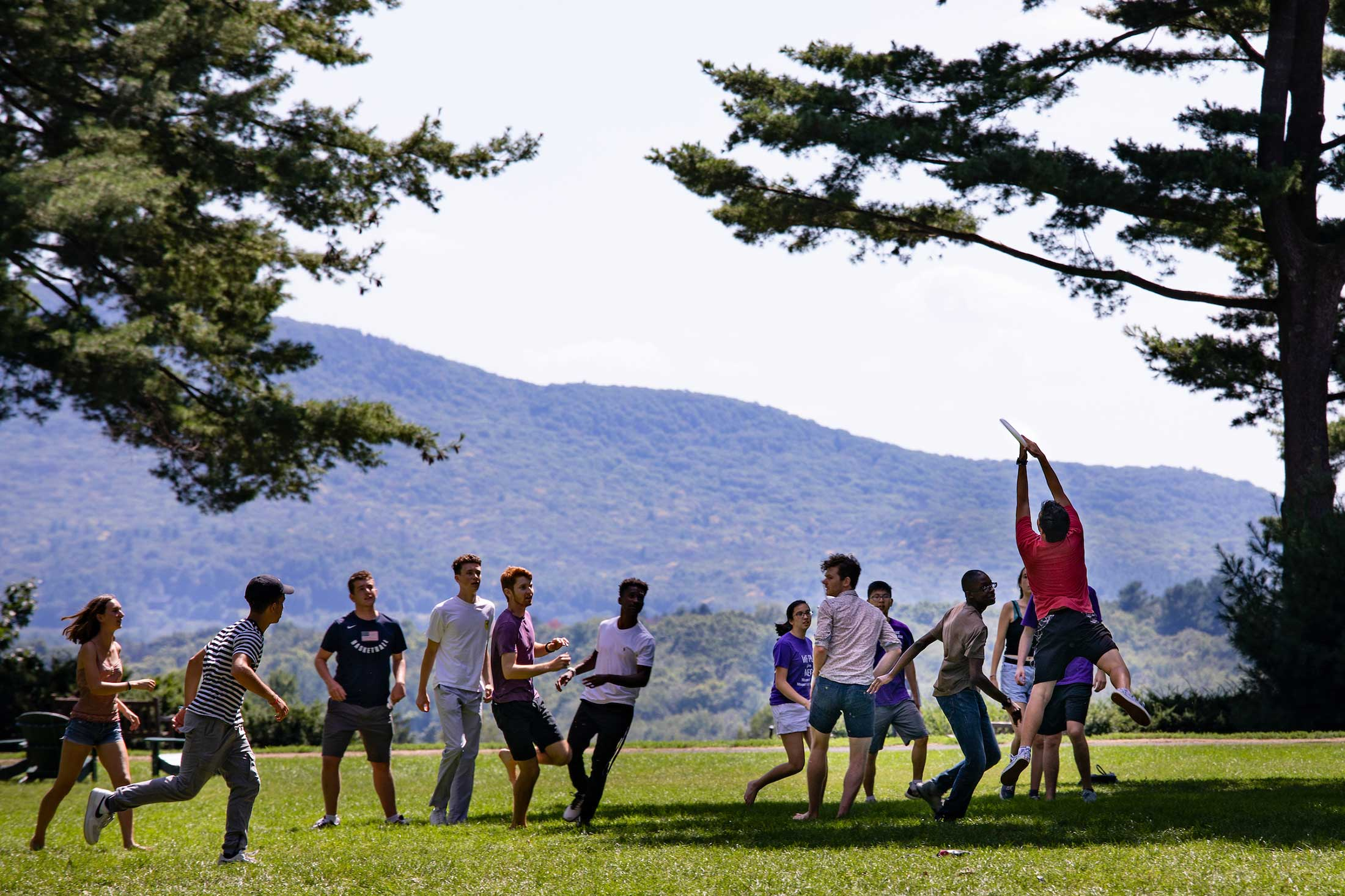 Students playing frisbee on the Academic quad