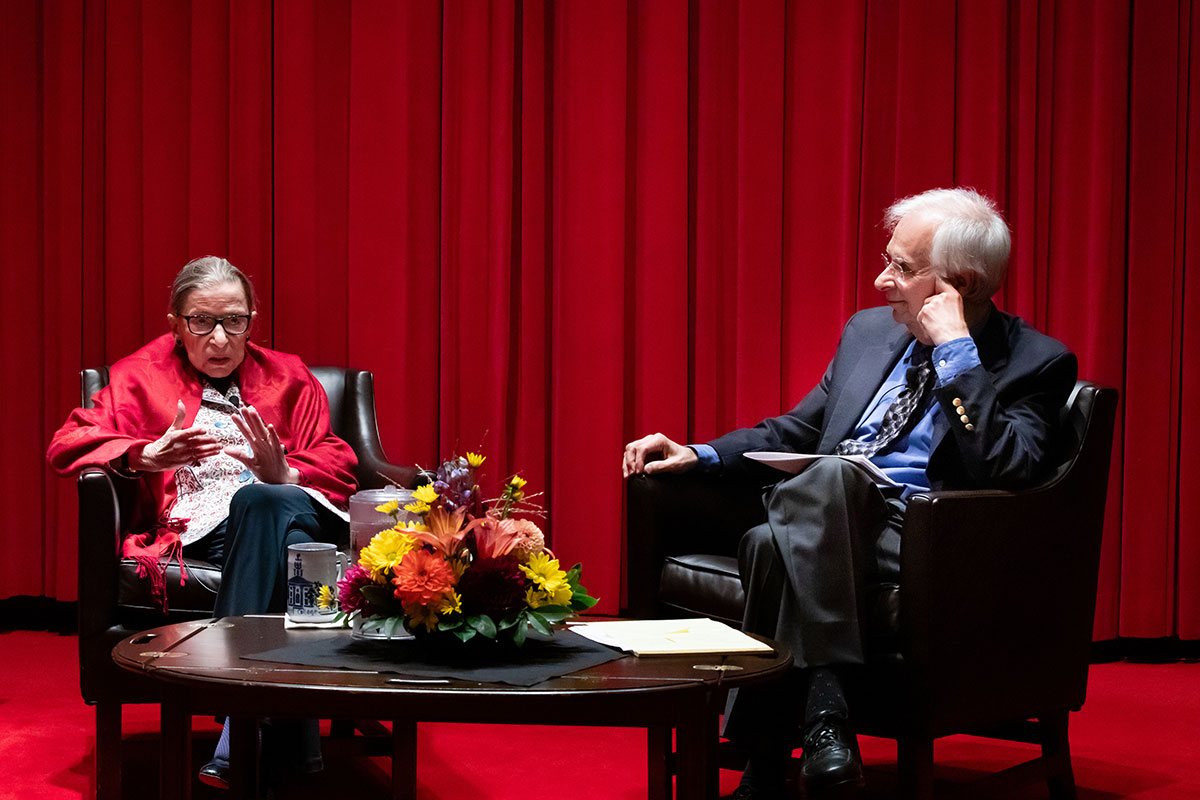 Justice Ruth Bader Ginsburg and Professor Austin Sarat sitting on a stage conversing