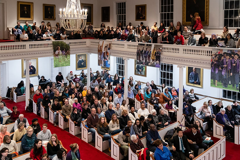 A large crowd fills Johnson Chapel on the campus of Amherst College