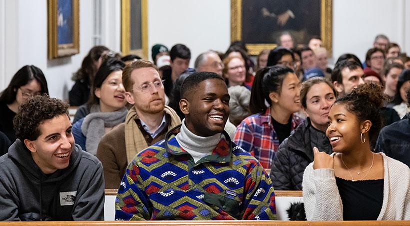 Audience members sitting inside Johnson Chapel react to Tara Westover and Tony Jack