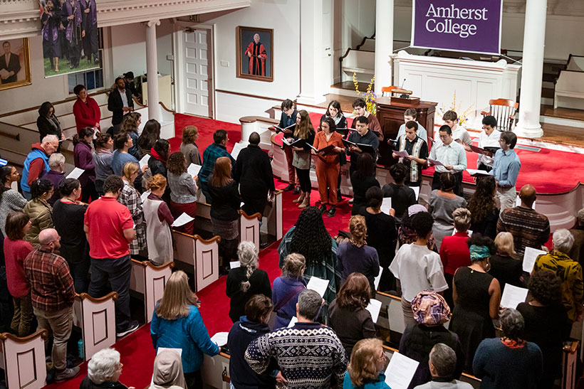 The Amherst Choral society performs to a crowd in Johnson Chapel