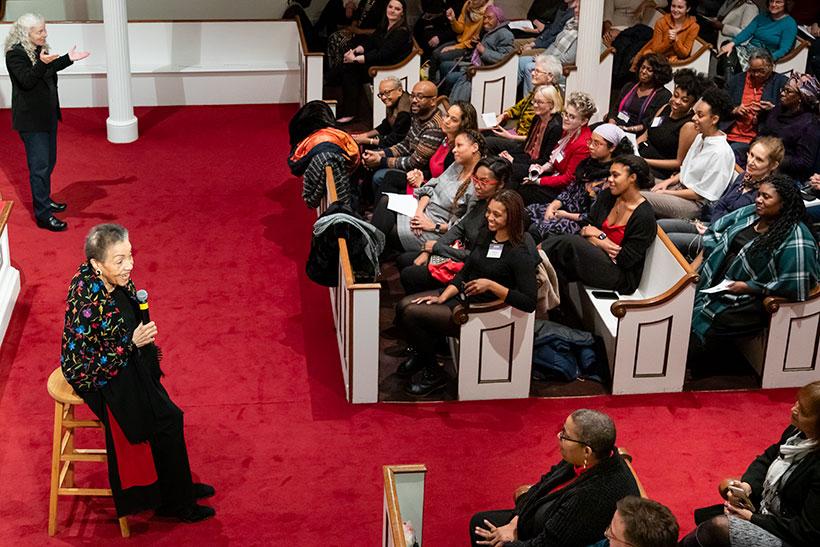 Jean Moss speaks to the audience inside Johnson Chapel