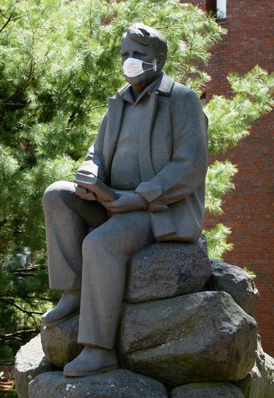 Robert Frost statue wearing a mask
